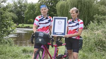 英國兩女以雙人腳踏車環球 遇火災.豪雨險阻仍創紀錄